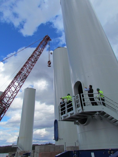 VIPs recently toured the interior of a bottom section of one of the towers for the Block Island Wind Farm, at a staging area on the Providence waterfront. (Tim Faulkner/ecoRI News)