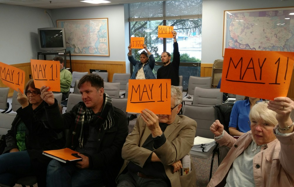 Supporters show the date of a two-week extension of the winter moratorium on gas and electric shutoffs. (Tim Faulkner/ecoRI News)