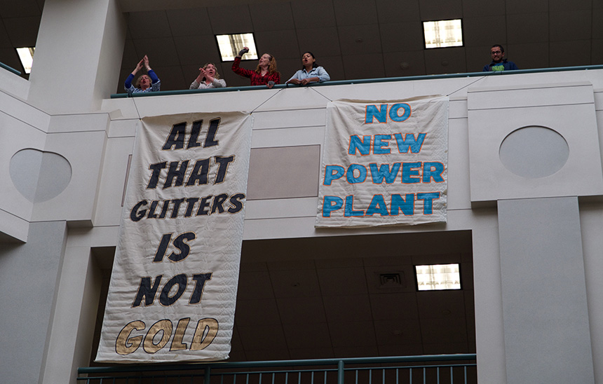 Protesters dropped banners April 18 at the Rhode Island Office of Energy Resources in opposition to the proposed Burrillville natural-gas power plant. (FANG)