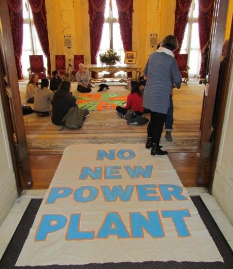 Climate activists occupied Gov. Gina Raimondo's office on April 19. (Tim Faulkner/ecoRI News)