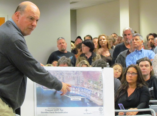 CRMC executive director Grover Fugate explains a new seawall proposal to council members. (Tim Faulkner/ecoRI News)