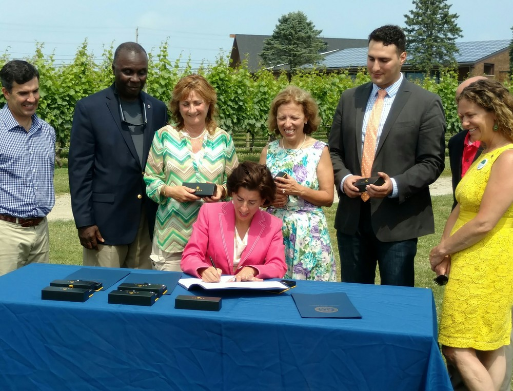 Gov. Gina Raimondo signed two renewable-energy bills into law July 7 at Newport Vineyards in Middletown, R.I. (Tim Faulkner/ecoRI News)