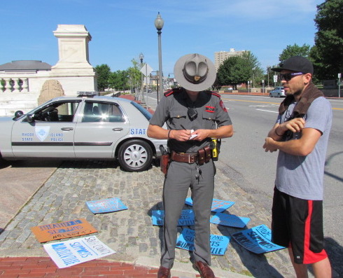 Nick Katkevich of The FANG Collective goes over details of the march with a state trooper.