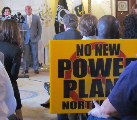 Anti-power-plant activists have followed Gov. Gina Raimondo to 30 public events, such as the announcement that General Electric is opening an office in Rhode Island.