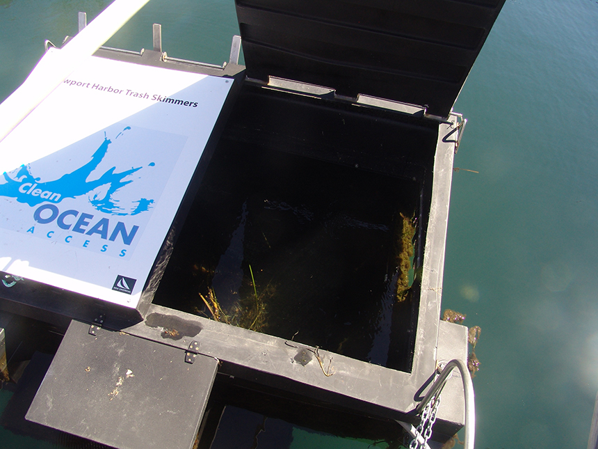 Two floating 'trash cans' were installed in Newport Harbor early last month to help clean the water and educate residents and tourists about the importance of their land-based behavior. The electric-powered skimmers suck up marine debris washed into the harbor by stormwater runoff and the wind; people don't actually throw trash directly into them. (Frank Carini/ecoRI News)