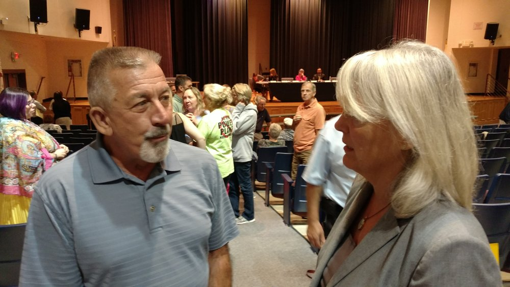 Burrillville resident Paul Bolduc speaks with Janet Coit of the Rhode Island Energy Facilities Siting Board during a Sept. 21 public hearing. (Tim Faulkner/ecoRI News)
