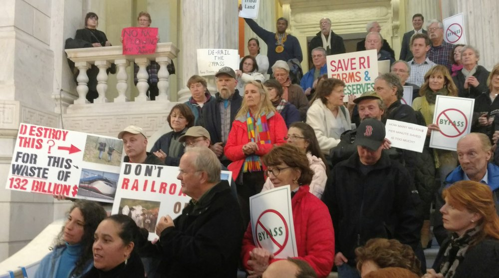Some 200 opponents of a Washington County rail project recently rallied at the Statehouse. (Tim Faulkner/ecoRI News)