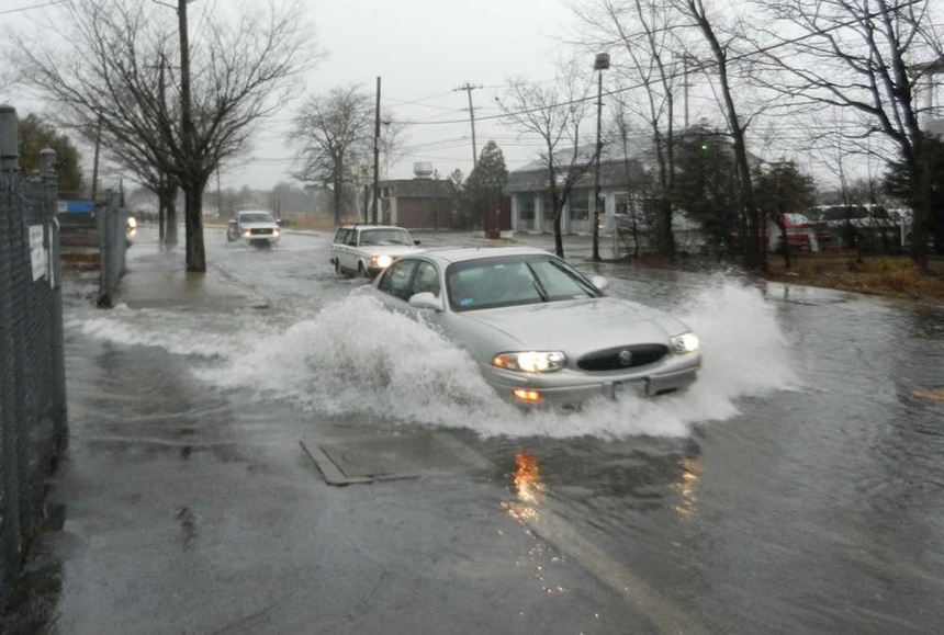 Main Street in Warren, R.I., is one of the state's most vulnerable roads to sea-level rise. This photo was taken in March 2014 during heavy rains and coastal flooding. (Tim Faulkner/ecoRI News)