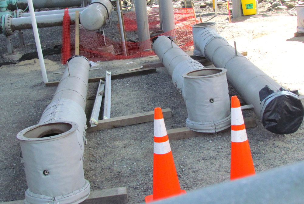 Natural-gas pipes, like these at the site of the March 29 leak in Providence, ruptured, releasing millions of cubic feet of natural gas. (Tim Faulkner/ecoRI News photos)