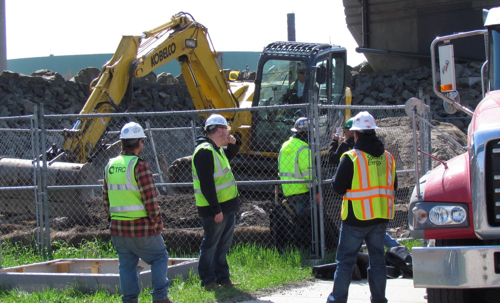 Soil removal during the clean up at the site of the March 29 natural-gas leak on Allens Avenue.