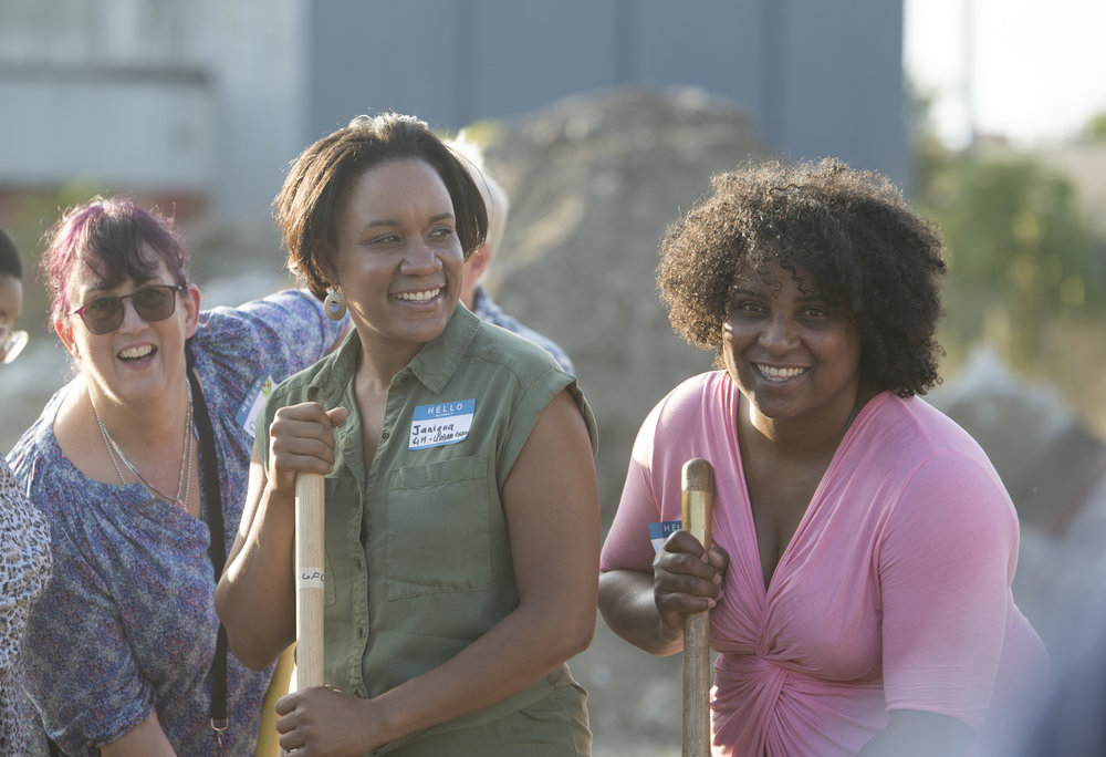 One of Urban Greens newest members is Janiqua Jackson, middle, who was recently hired to be the store's general manager. She recently helped break ground with other co-op members and community stakeholders.