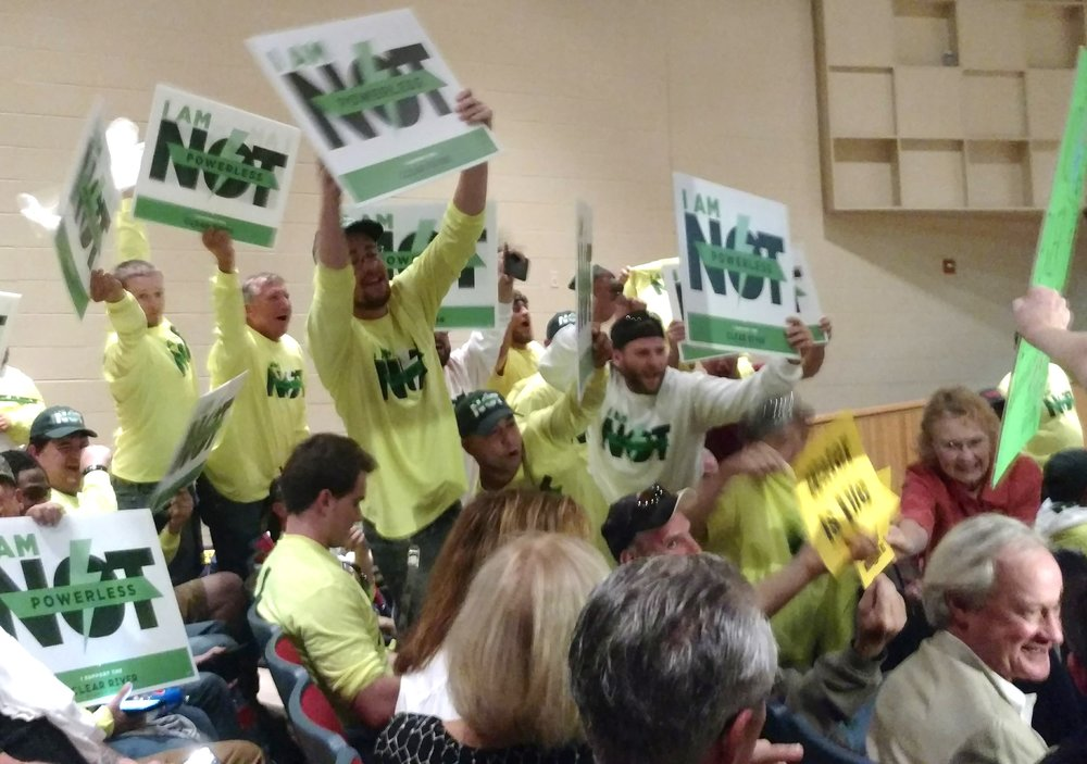 Union members who support the power plant had their own T-shirts and signs. They were loud but left early. (Tim Faulkner/ecoRI News photos)