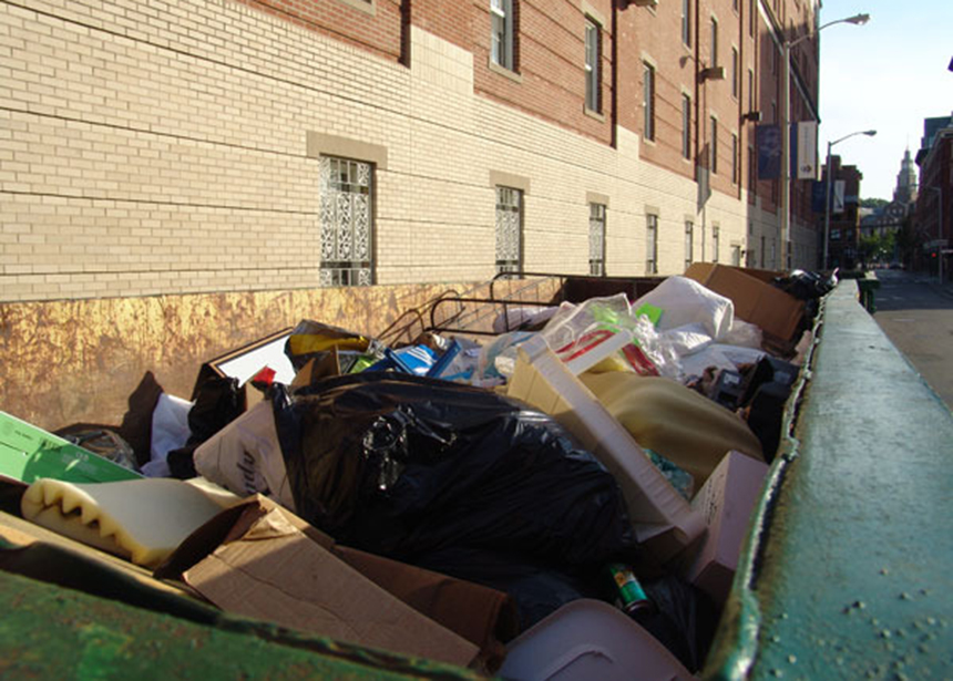 This photo of a Johnson & Wales University Dumpster taken several years ago captures the problem of recyclables being tossed out with trash when students leave for the year. (ecoRI News)