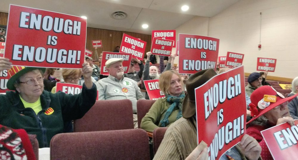 Opponents of the proposed Clear River Energy Center dominated hearings Dec. 5 and this one Dec. 6 at Burrillville Middle School. (Tim Faulkner/ecoRI News)