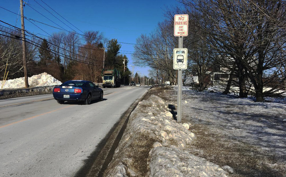 A bus stop on Bristol Ferry Road in Portsmouth, R.I., on Jan. 10, five days after a winter storm dumped a foot of snow. (Joanna Detz/ecoRI News)