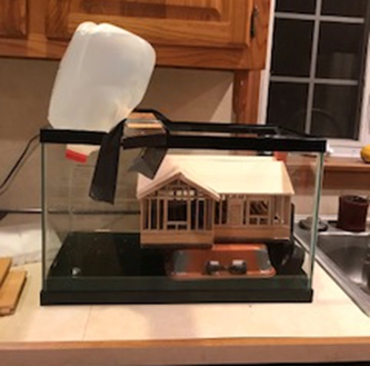 Coventry High School student Abigail Harbeck developed a model for 'amphibious houses' that could be built in flood-prone regions.