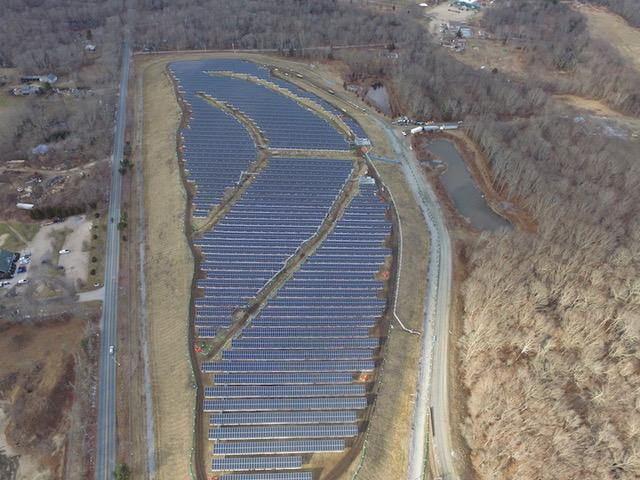The Rose Hill landfill solar array, above, is 4.7 megawatts and the Plains Road landfill site is 4.6, for a total of 9.3 megawatts, or enough solar energy to power 1,250 homes. (Kearsarge Energy)