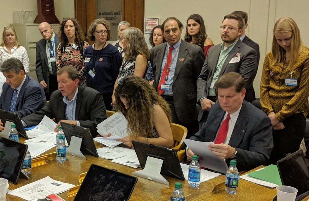 Leaders from several Rhode Island environmental groups stood in opposition as a vote was taken on a bill in support of biomass energy and a wood-fuel facility in Johnston. (Tim Faulkner/ecoRI News)