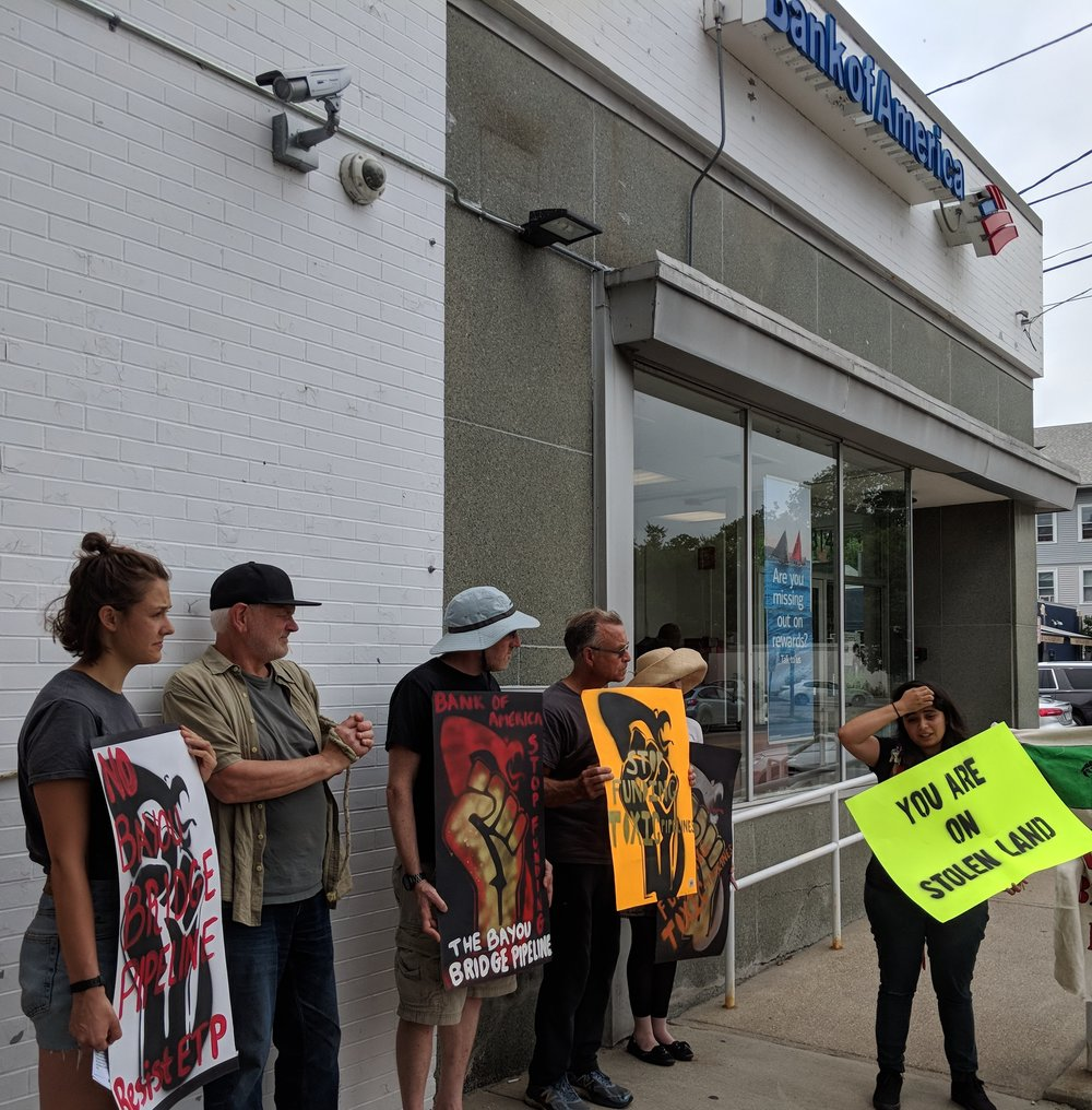 Protesters urged Bank of America customers to close their accounts at the Hope Street branch in Providence on July 30.