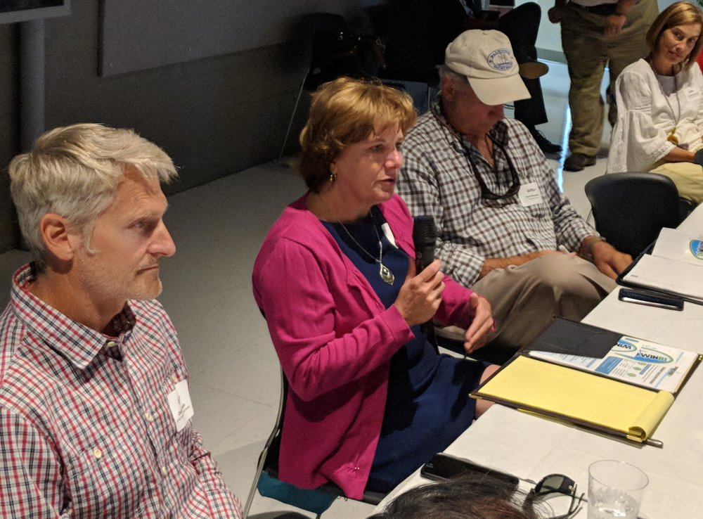 Marine and education professionals discuss a new wind-energy training and education program. (Tim Faulkner/ecoRI News)