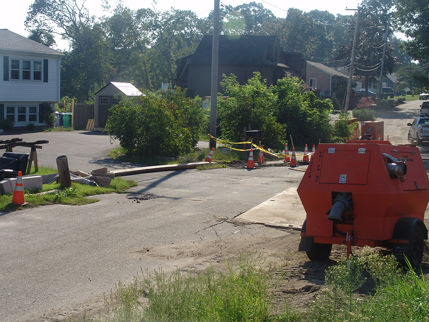 The Cedar Swamp Road worksite in Warwick, R.I., has been bustling with workers and equipment since a sewer line collapsed a week ago. (Frank Carini/ecoRI News photos)