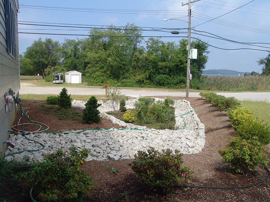 The rain garden at Common Fence Point Community Hall in Portsmouth, R.I., was built in one day with help from 40 volunteers. The garden collects rain from the roof, decreasing flooding and filtering polluted runoff. (Frank Carini/ecoRI News)