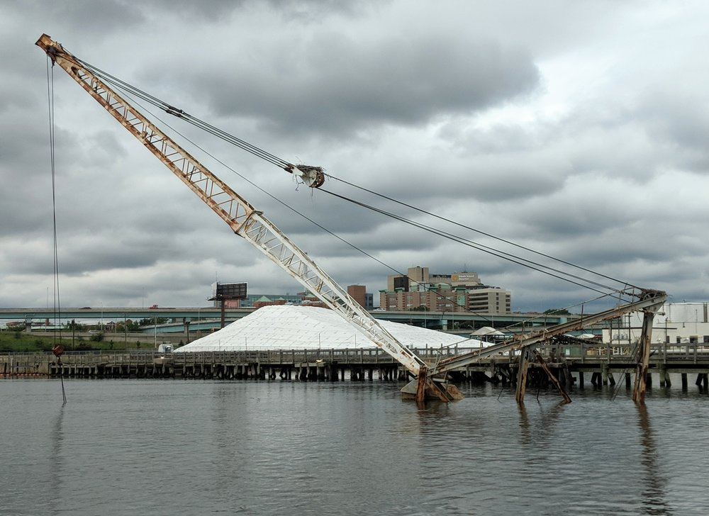 A sunken crane barge has been sitting in the water for nearly a year. (Tim Faulkner/ecoRI News photos)