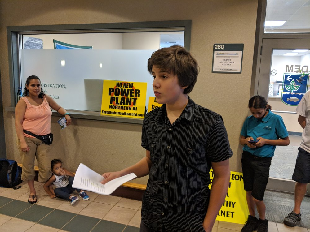 'It is so disappointing that the state won't listen to us,' said Philip Tierney, 14, of East Providence, R.I. 'Climate change is coming at a rapid pace, and they don't do anything about it. The future looks scary.' (Tim Faulkner/ecoRI News)