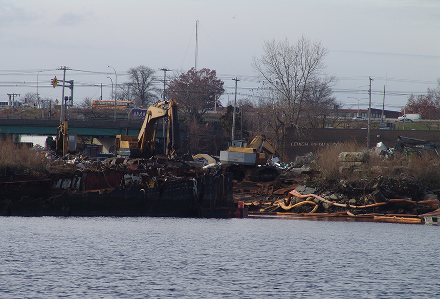 Rhode Island Recycled Metals has been operating a scrap-metal facility along the Providence waterfront for nearly a decade without all of the required permits. The business, for example, has few if any stormwater controls in place. (Frank Carini/ecoRI News)