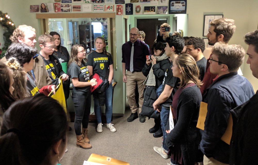 Activists from the Sunrise Movement and other environmental groups at the office of Rep. Jim Langevin, D-R.I. (Tim Faulkner/ecoRI News)