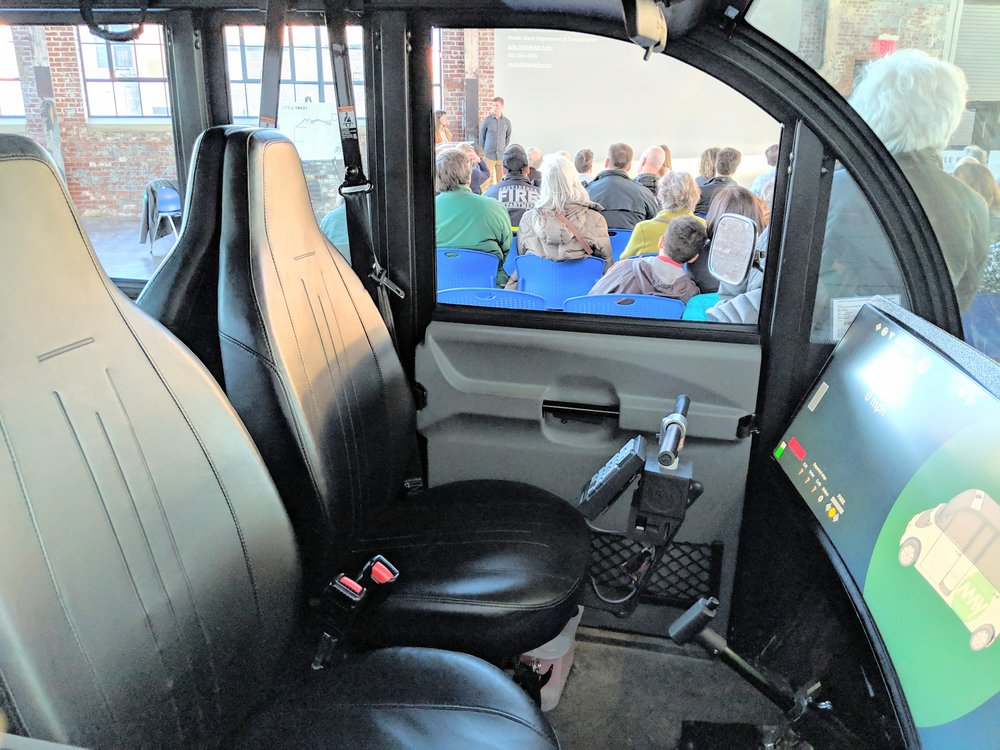 No steering wheel, but an attendant can control the vehicle with the joystick. (Tim Faulkner/ecoRI News)