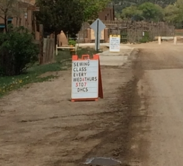 sign on the pueblo.  this is our common thread