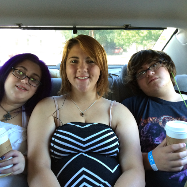 Teens cramped in the backseat of a car need frequent rest breaks.  They look happy now, but...