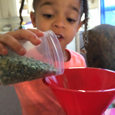 Zare helped fill the bean bags with lentils.