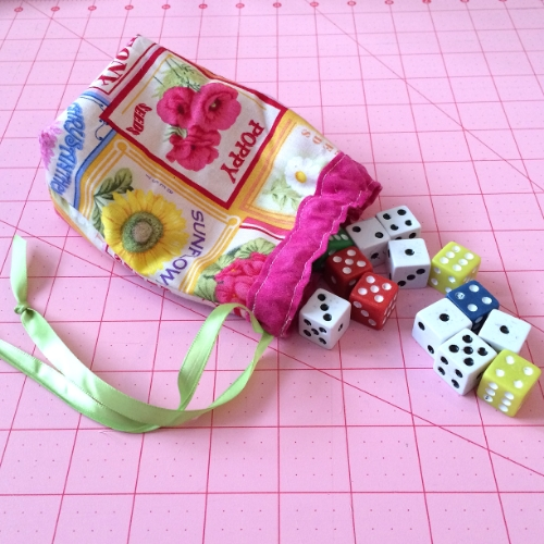 Sew a little pouch, add dice and you have a great game for Family night.  Dice games are educational, cheap, fun, and suitable for all ages.