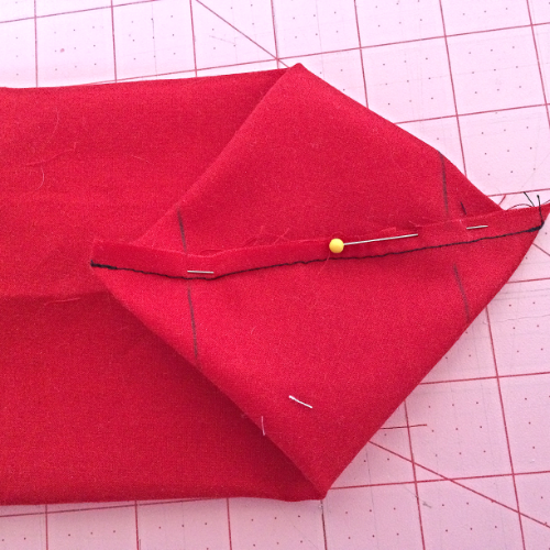 Stitch on the lines.  then trim the corners off with about a 1/4 inch seam allowance.