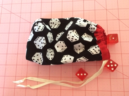 This is a darling little pouch. and it is a greay way to store your dice.