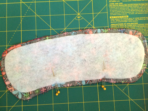 FUSE THE FLEECE INTERFACING AND MARK THE OPENING WITH DOUBLE PINS