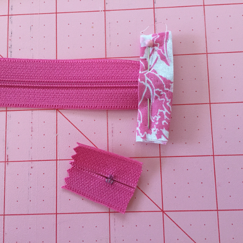 When sewing on the tab make sure you sew slowly and carefully over the nylon teeth.