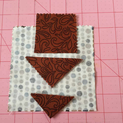 Start with a 2 1/2 inch square, fold in half, and then fold in half again to make the tail feather.  in quilting this is called a prairie point.