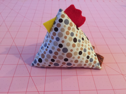 Isn't he cute?  These chickens can be made with any size square.  All you need are two squares the same size.