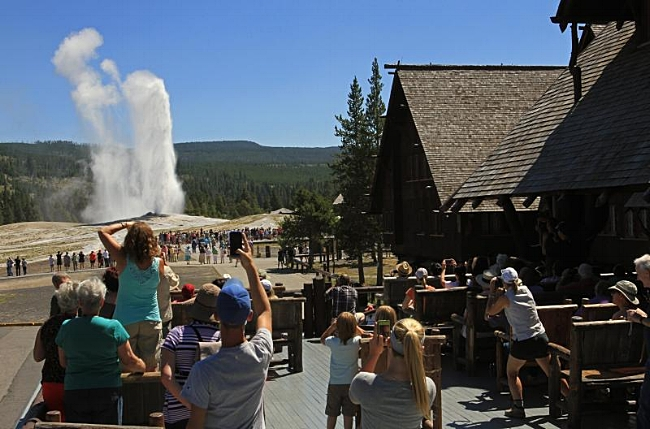 Watching Old Faithful Erupt from the Deck at the Old Faithful Lodge in Yellowstone National Park