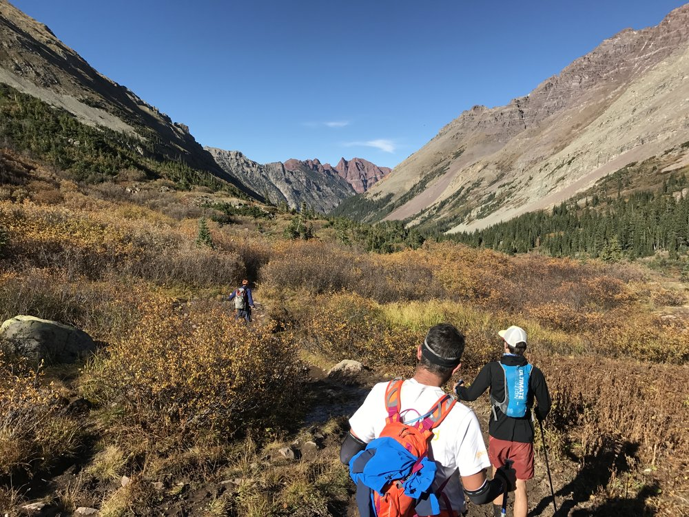 Pushing through the last few miles in the shadow of the Maroon Bells.