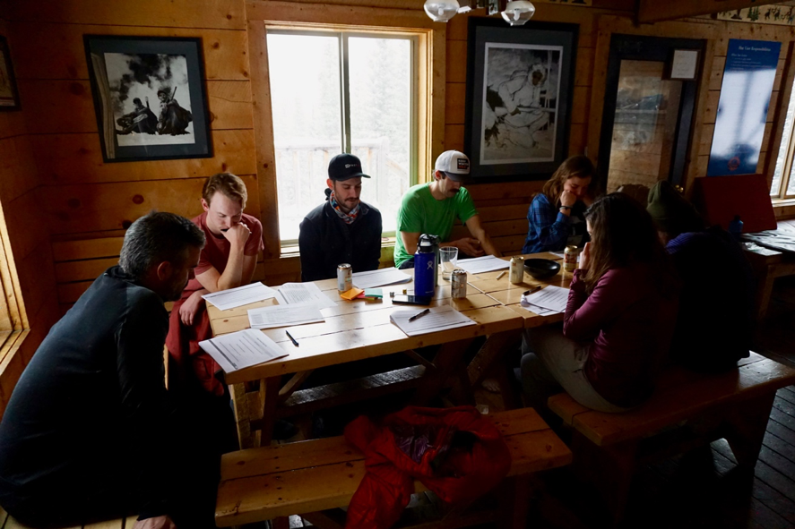 The FASTG8 team bowing their heads in prayer, in hopes that the powder gods would soon be there.