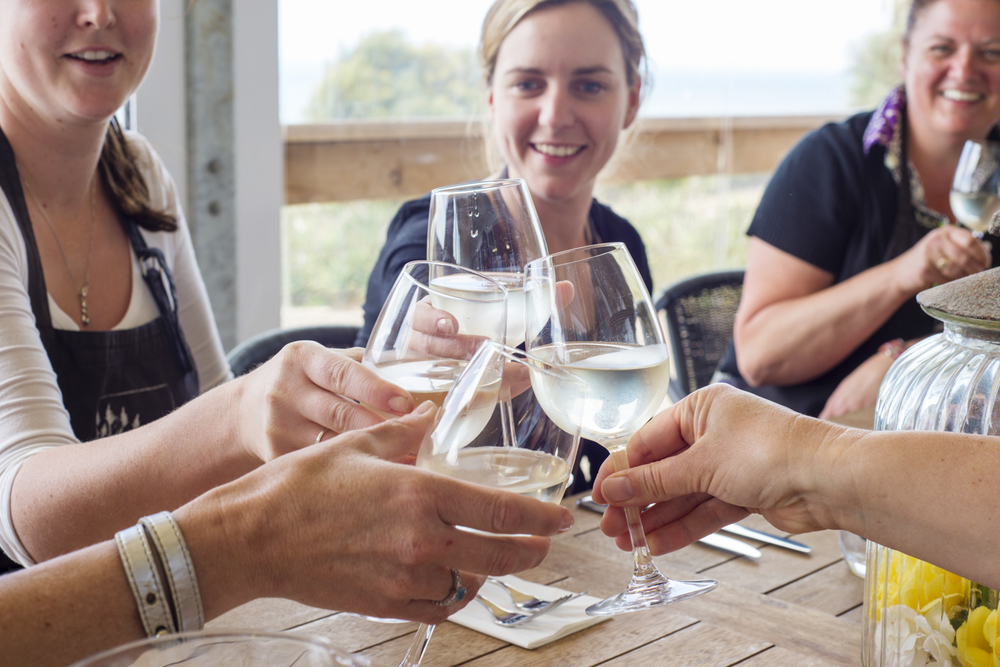 The hands lead the eye in to the focus of this image, the wine glasses.