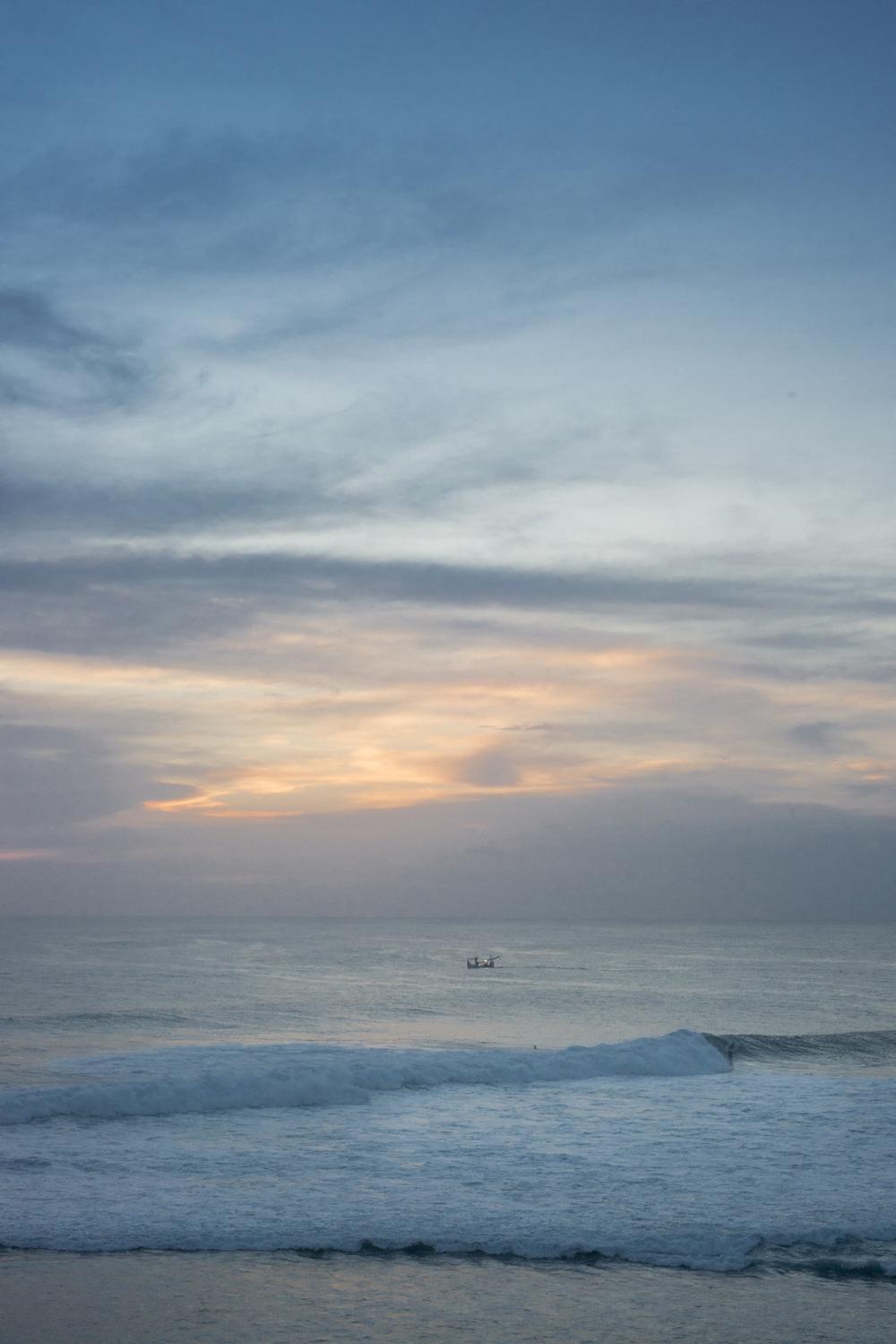 Big swell at Uluwatu. Spot the surfer - looks like an ant.