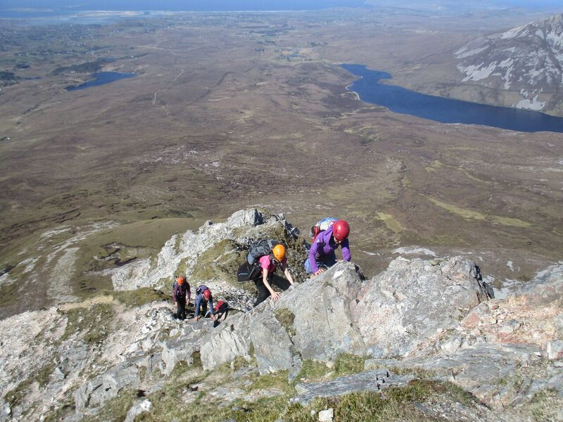 Errigal group - Women With Altitude participants scrambling up the north ridge of Errigal, with Altan Lough in background, photo Colette Mahon..jpg