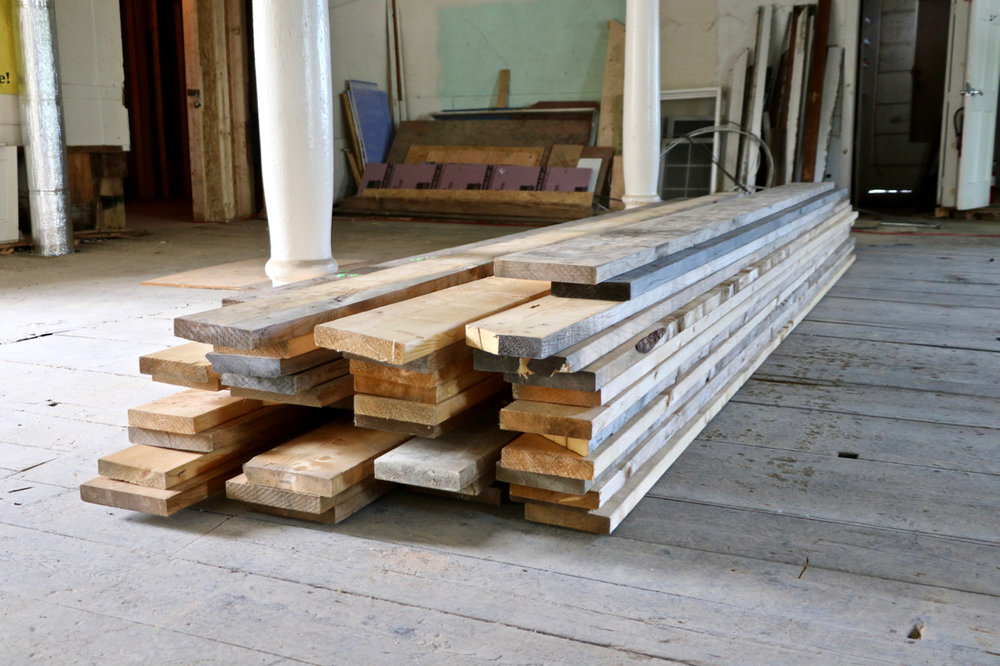 Lumber Ready to Become Staaing Inside the Tower.jpg