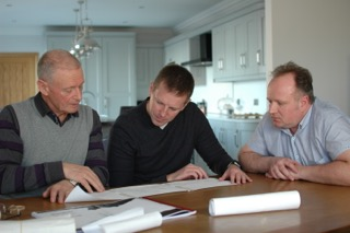 Rev. MacGregor descendent Alan Laughlin and son Ainsley with BBC presenter Gavin Andrews (center) study their long family tree.