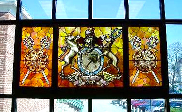 MacGregor family coat of arms window in the Derry Public Library (photo courtesy DPL).